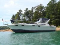 This sport cabin cruiser has a wide 12' beam for a