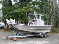 "24' 6"" hull, 9' 6"" beam, twin Crusader V-6 engines,"