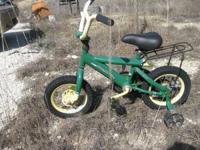Small John Deere childs bike with training wheels.