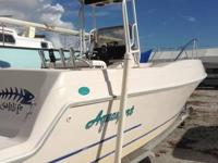 This is a  24' Aquasport center console with a