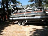 Tracker Party Barge Patio Boat with a 2005 Yamaha 80