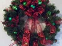This is a 24 inch wreath decorated with green