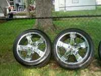 I AM SELLING FOUR 24IN RIMS AND TIRES THEY ARE LOW