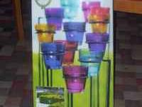 Really cute 24 piece colored glass candle set w/