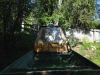 24 foot flat bottom river boat with homemade cab,