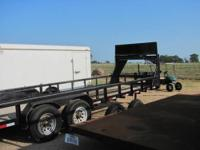 THIS IS A 24' X 6 1/2' FLAT BED HEAVY DUTY GOOSE NECK