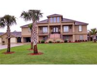 242 GULFWAY DRIVE WATERFRONT PARADISE! Upper level has