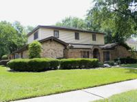 THIS TRADITIONAL 2 TALE WOODFOREST HOME IS SIMPLY