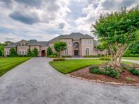 Lovely estate on 8.21 acs in gated equestrian subd!