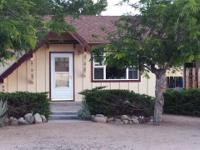 Cute, cozy, cabin style home with vaulted ceilings,