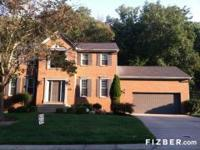 Beautiful brick wrap home with personal wooded backyard