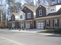 Like new condo with fenced yard and one car garage.