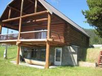 Three bedroom log cabin with two baths  and creek on