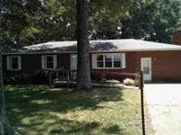 Huge 3 bedroom brick house with double carport,