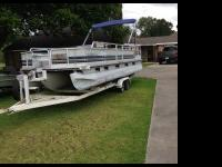 24 ft tracker  party parge with 3 pontoons, 2000 90 HP