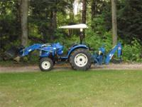 For Sale - 2006 New Holland TC35A tractor. - Four wheel