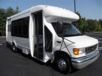 2004 Ford Startrans fiberglass E-450 bus with two