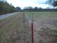 25 acres hay field that is fully fenced with a stock