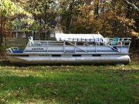 25 Ft. Crest Pontoon w/ 50 HP Johnson outboard motor.