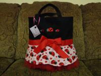 This is a full sized tote embellished with a cute pink