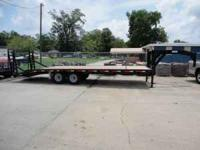 New 25' gooseneck trailer. Trailer has dove tail with