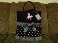 This is a full size tote, embellished with a cute skirt