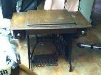 OLD SINGER SEWING MACHINE IN CABINET, CAST-IRON LEGS