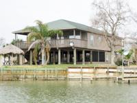 Beautiful one of a kind customized waterside home