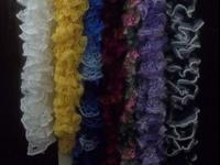 This is a photo of a variety of colors of scarfs that