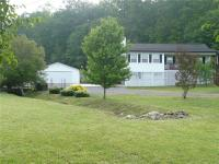 GARDENERS DREAM HOME ON 3.06 ACRES...Your living is all