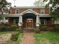 Just reduced! This spacious four-level all brick