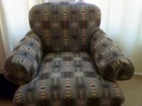 This lovely decorator western design fabric sofa chair