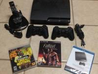 PS3 Slim with 2 controllers and charging station,