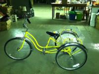 Like new, bright yellow TRIKE. A 3 wheel bike with a