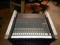 Mackie CR1604 16 channel mixer with a travel case on