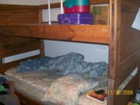 We are selling our daughter's Solid Wood Twin Bunk Beds