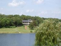 Lake Front Home sits on 3.25 acres located on 35 Acre