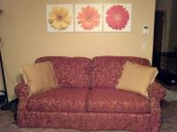 I'm selling a beautiful Lane sofa. It is red or rust