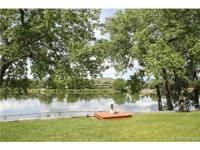 Incredible Location on Maple Grove Reservoir, Direct