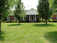 3,400 sq' 3 BR 3.5 bath custom brick home on 38 acres