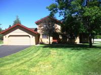 CREEK FRONTAGE! Beautifully maintained spacious home on