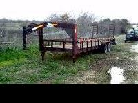 This is a 2007 model Lo Boy Goose neck trailer with