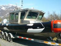 I am offering my Ex 2005 U.S Coast Guard Safe boat, The