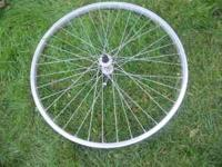 "This is a 26"" front rim of a mountain bike. It is"