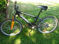 "Huffy 26"" 21 speed with front suspension, $50. Call or"