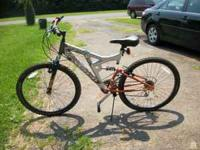 "I am selling a 26"" Mountain Bike. It is silver and"