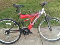 21 speed mountain bike has aluminum frame, front and
