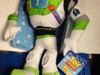 New, Plush Buzz Lightyear toy. Hard plastic helmet.