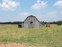 50 +/- Acre Farm for sale with 3 barns, 2 ponds and a