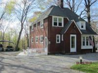 Sits back off the street on a 1.27 acre wooded lot,